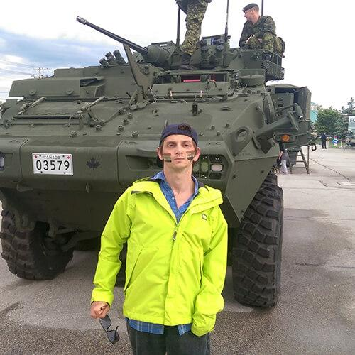 Jarod In Front Of Tank